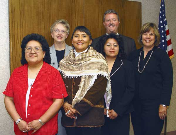 The UNM-G Local Board for 2005 includes two new members: third from left, Gloria Skeet de Cruz, and to her right, June Shack. Returning members are Chair Ruby Wolf, left; Vice Chair Brett Newberry, back, second from right, and Secretary Theresa Dowling, right. Also shown is Dr. Beth Miller, Executive Director.